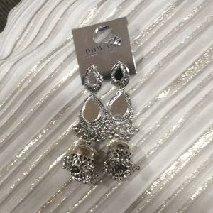 Unique silver color mirror dangling earrings.